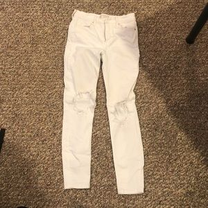 Free People white jeans with holes in the knees